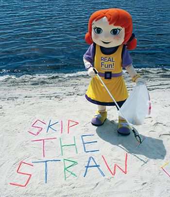 Fiona Fun! picks up straws that have washed up on the beach