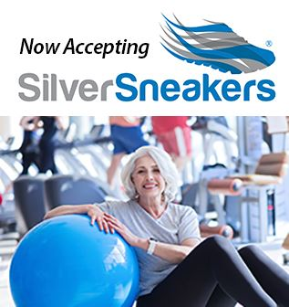 Now Accepting Silver Sneakers. Senior woman with exercise ball in fitness center.