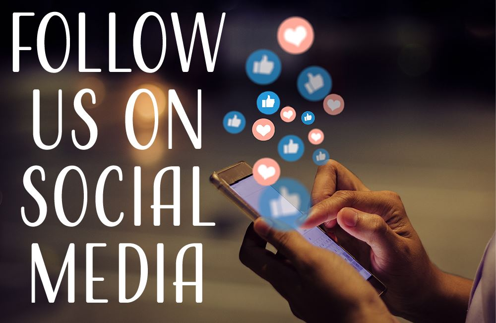 Follow Us on Social Media written of picture of hands holding smart phone using social media.