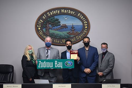 Safety Harbor Commissioner and Mayor gather with Commissioner Zodrow at his last meeting